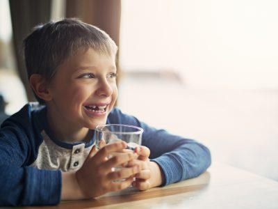 Cute little boy with water